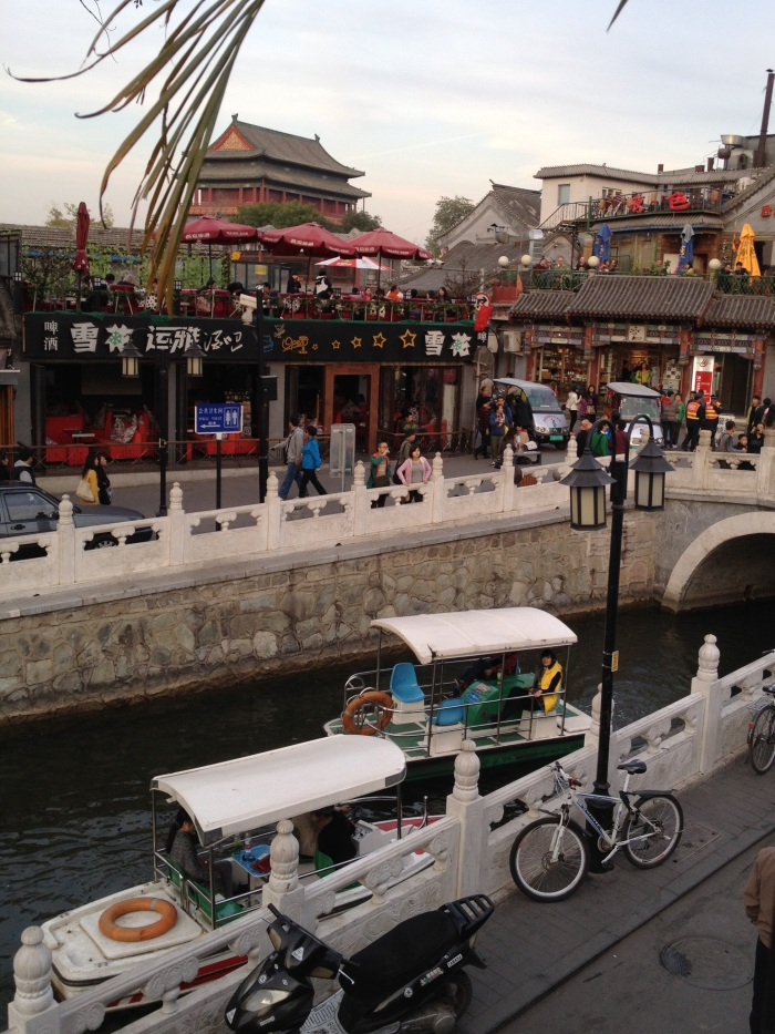 The central hub of Lake HouHai viewed from a rooftop bar. In the back is the Drum Tower (Gu Lou)